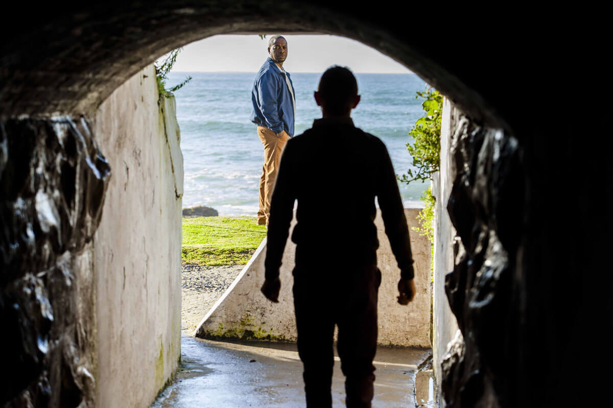 WYWL St James Passage Mack (Lionel Newton) walks towards Joe (Fezile Mpela)