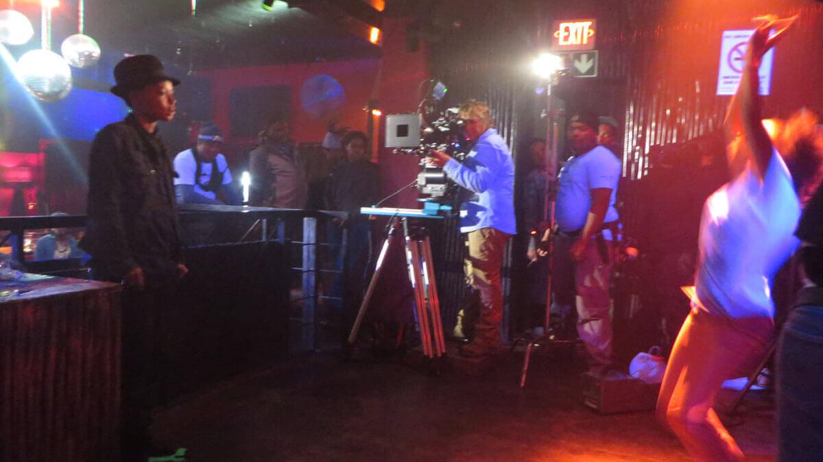 WYWL Crew Bar Shado (Thishiwe Ziqubu) watches Asanda (Petronella Tshuma)